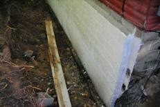 Shows_damp_proofing_and_drain_tile_along_wall-231x155