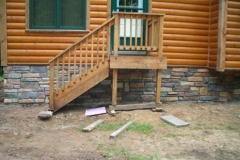 stone_on_cabin_for_jeff_and_Barb_Nadeau_right_side_of_steps_is_after_sealer-495x368